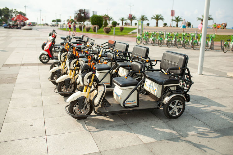 Electric motor bike for rent at the Batumi Georgia 2018 Mode Of Transportation Transportation Motorcycle Land Vehicle Street City Day Scooter In A Row Stationary Incidental People Parking Motor Scooter Outdoors Focus On Foreground Large Group Of Objects Footpath Nature Road Tiled Floor Paving Stone Rental Rental Bikes Electricity