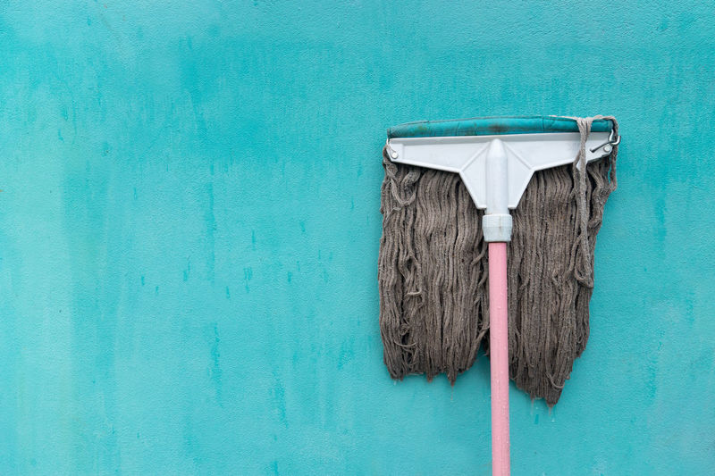 Mop on blue wall