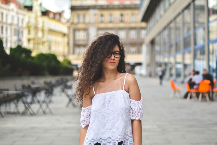 Portrait Of Young Woman Standing On City Street