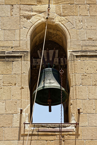 An old tower bell in Nicosia, Cyprus. Cyprus Nicosia Old Town Arch Architecture Bell Brick Brick Wall Building Building Exterior Built Structure Day Electric Lamp Hanging History Lighting Equipment Low Angle View No People Old Old Ruin Outdoors Stone Wall The Past Tower Bell Wall Wall - Building Feature Window