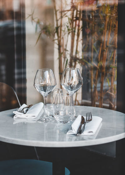 Table Glass Wineglass Glass - Material Eating Utensil Transparent Setting Drinking Glass Fork Place Setting No People Household Equipment Absence Food And Drink Kitchen Utensil Restaurant Indoors  Reflection Business Day Table Knife Crockery