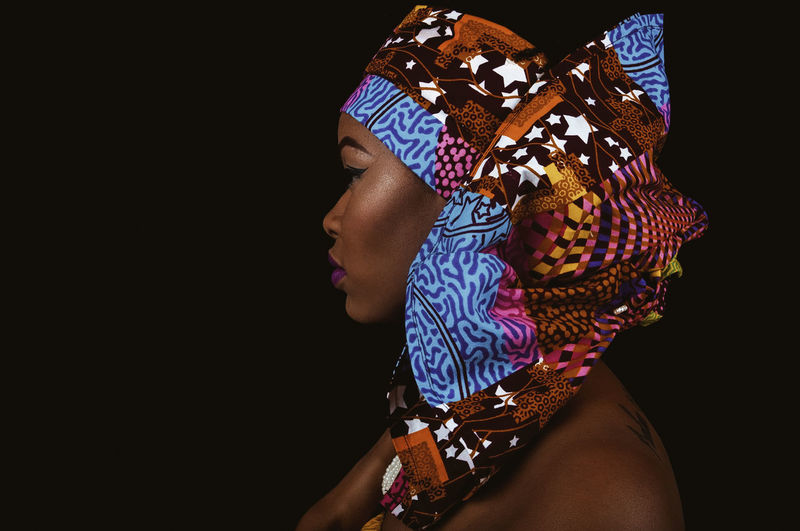Black Woman Portrait Headwrap  Accessories African Fabric African Accessories Beautiful Woman Black Background One Person Studio Shot Indoors  Lifestyles Women Copy Space Adult Headshot Arts Culture And Entertainment Real People Close-up Human Body Part Pattern Clothing Looking Young Adult Headdress Human Face