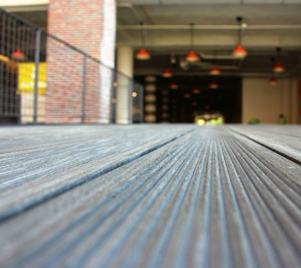 Surface Level On Wooden Floor Against Building