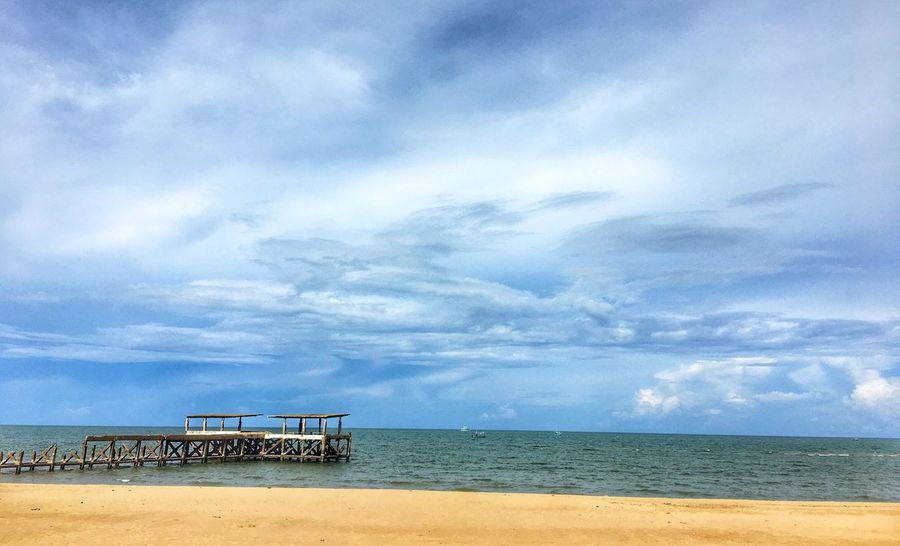 Sea Sky Water Horizon Over Water Cloud - Sky Beach Tranquil Scene Scenics Tranquility Day Beauty In Nature Nature Outdoors No People Sand Built Structure Vacations Architecture
