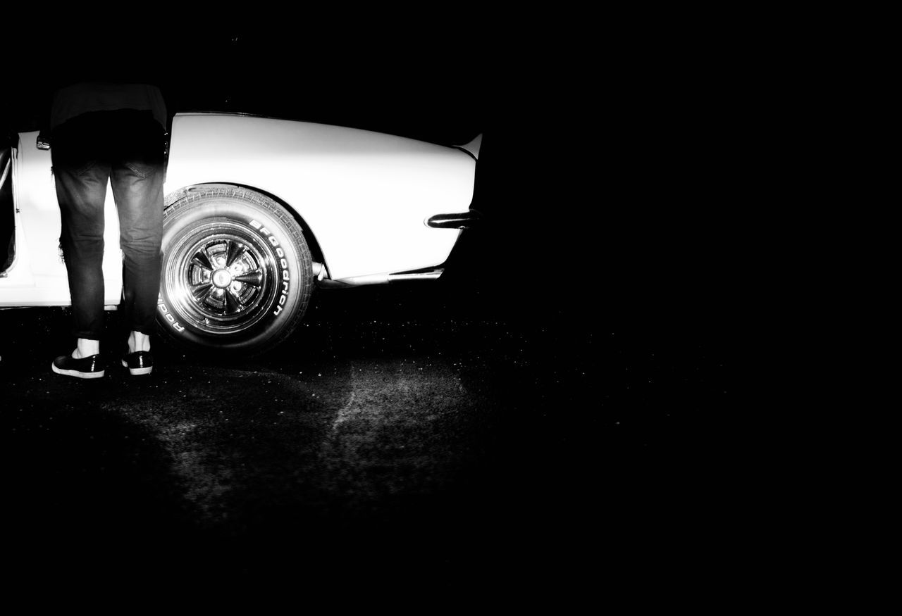 car, transportation, land vehicle, low section, one person, mode of transport, night, real people, outdoors, tire, people