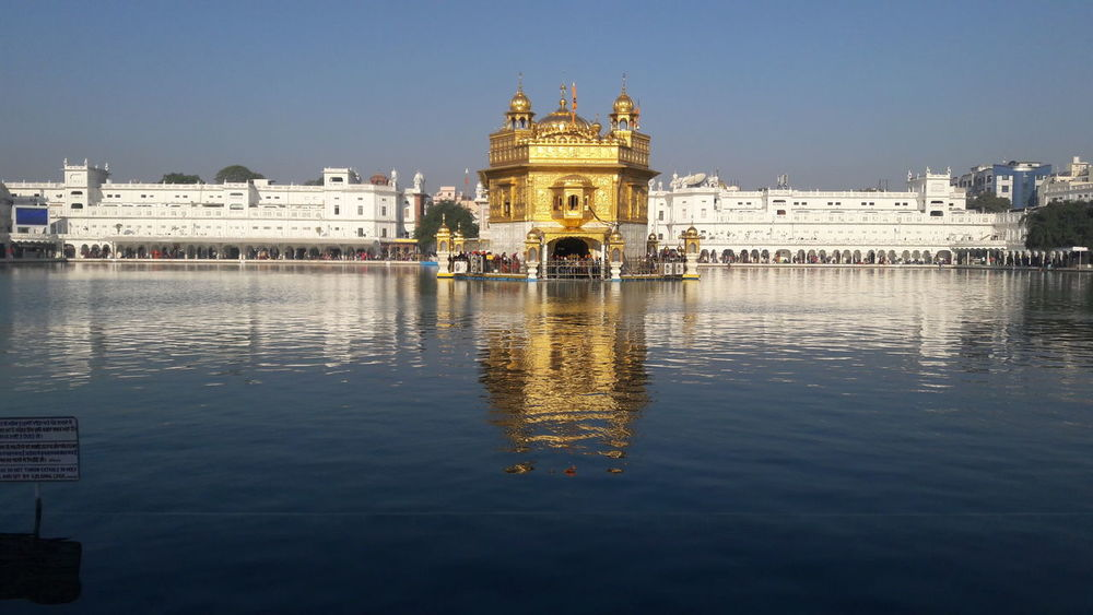 Amritsar, INDIA Amritsar Punjab Gurudwara Golden Temple Lovelovelove Free Spirit Religious  Architecture Built Structure Building Exterior Water Reflection Waterfront History Outdoors Day Travel Destinations Sky City No People Clear Sky Nature Shades Of Winter Fashion Stories EyeEmNewHere