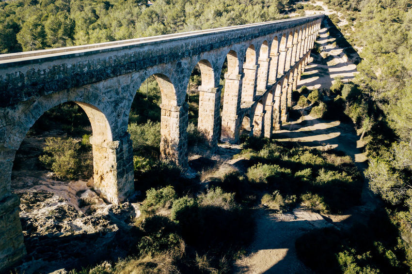 Aqueduct DJI X Eyeem Drone  The Ferreres Aqueduct Aerial Aerial View Architecture Bridge Bridge - Man Made Structure Building Exterior Built Structure Day Dronephotography History Nature No People Old Outdoors Sunlight Tree