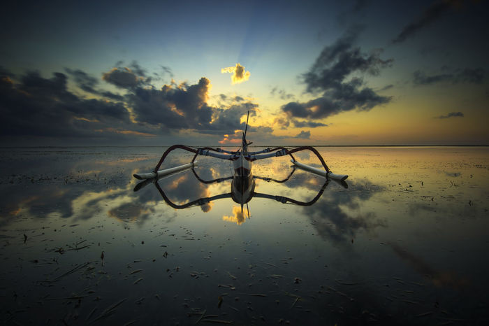 Jukung Eyemphotography Eyem Best Shots Eyem Gallery Bali INDONESIA Serenity Silent Peaceful Sunset_collection Cloud - Sky Sea Seascape Sunrise Travel Destinations Tourism Nature Photography Beach Amazing Water Sea Silhouette Reflection Sun Galaxy Sky Postcard Boat Shore Surf Sailing Boat