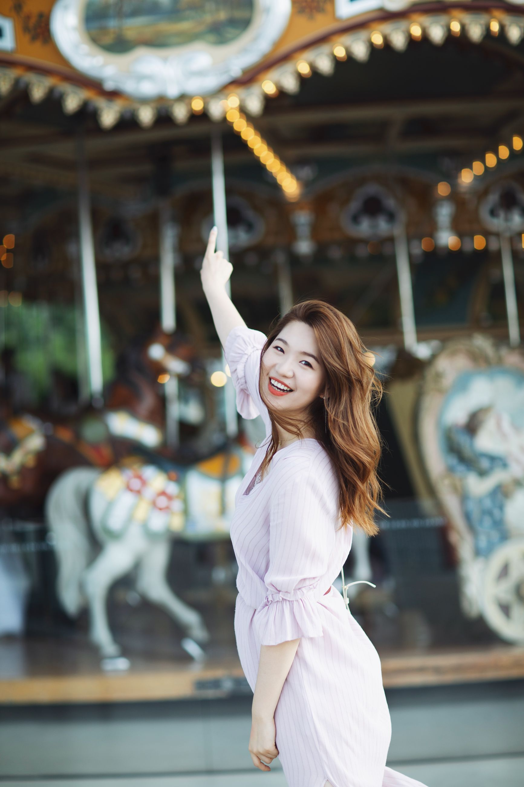 one person, smiling, happiness, hairstyle, young women, arts culture and entertainment, young adult, leisure activity, focus on foreground, real people, hair, women, long hair, amusement park ride, emotion, amusement park, lifestyles, portrait, standing, beautiful woman, human arm
