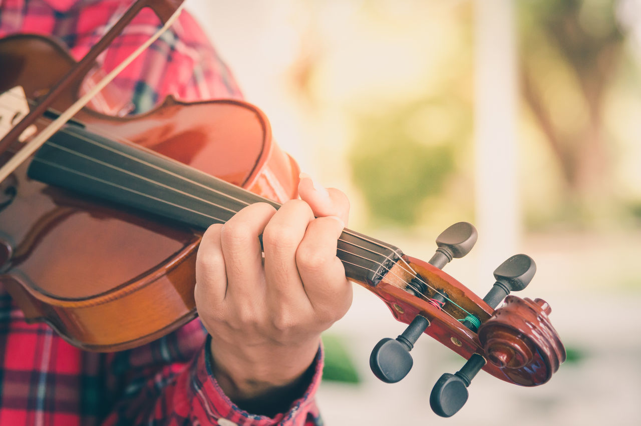 Close-Up Of Woman Playing Violin