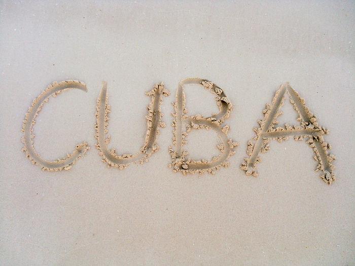 High angle view of cuba written on sandy beach