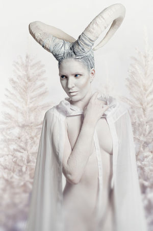 Female with goat body-art isolated on white. Dedicated to Chinese Horoscope 2015 - Year of the Goat (Sheep) Aries December Goat Horned Woman Horns Horoscope  New Year Winter Woman Zodiac Sign Astrology Sign Beautiful Woman Body Paint Bodyart Character Christmas Tree Cloak Conceptual Female Horned Naked_art One Person Sheep Women Young Women