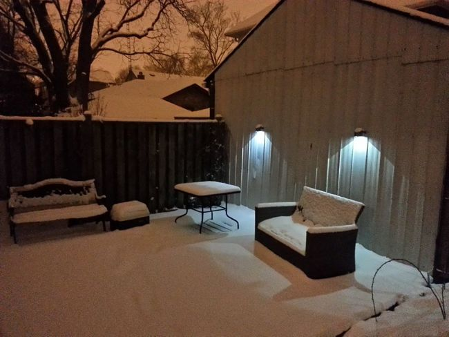 Under Snow Early Spring Snowcovered Deck Deck Furniture Night Lights Night View Solar Lights Sconce Spring Is Not Here