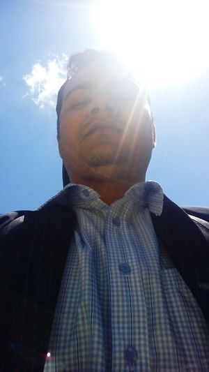 Lens Flare One Man Only Sunbeam One Person Only Men Adults Only People Young Adult Sun Adult Headshot One Young Man Only Sunlight Day Sky Outdoors Men Nature Pixelated First Eyeem Photo