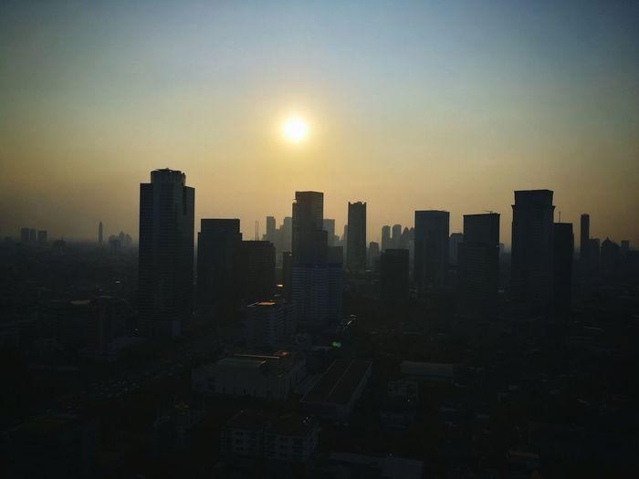 Afternoon at Jakarta City Cityscape Urban Skyline Skyscraper Modern Sunset Illuminated Downtown District Sky Architecture Dramatic Sky Atmospheric Mood Romantic Sky