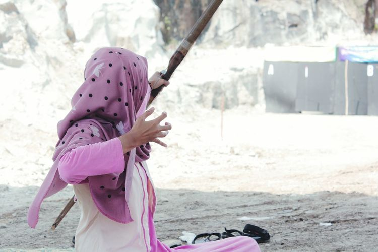 Woman Practicing With Archery