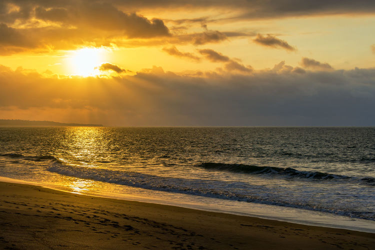 Dramatic sunset over the Pacific Ocean in Same, Ecuador Beach Beauty In Nature Day Ecuador Horizon Over Water Idyllic Landscape Nature No People Ocean Orange Orange Color Outdoors Pacific Pacific Ocean Same  Sand Sea South America Sunlight Sunset Tourism Travel Travel Destinations Water