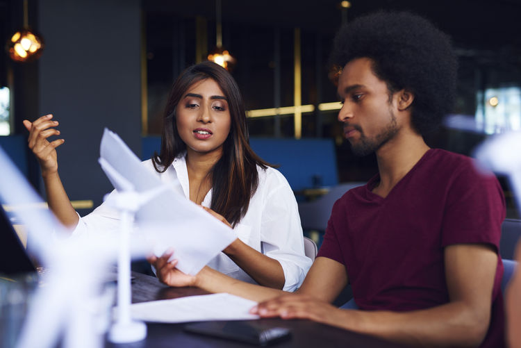 Business people couple discussing at desk in office