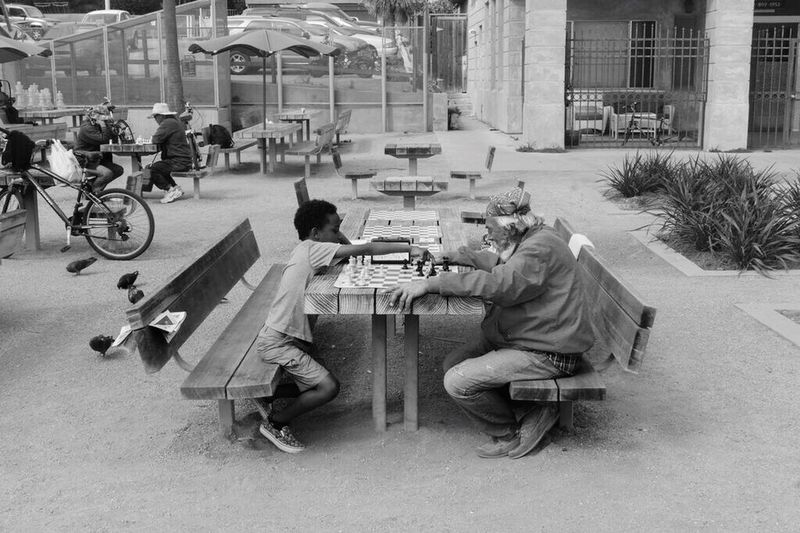 One day the master will be defeated. Blackandwhite Blackandwhite Photography Bw Photography Street Photography Kid Elderly Old Playing Chess Story Cute Moments Great Atmosphere Beautiful Moments Sunny Day Hanging Out Los Angeles, California Santa Monica Beach Life Showcase July People Together
