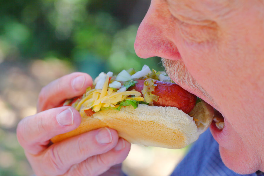 Man eating hot dog with relish and onions Dinner Homemade Food Hot Dog Lunch Man Meal Adult Male American Food Bread Bun Cheese Chopped Onion Close-up Day Delicious Food Freshness Holding One Person Outdoors Raw Onion Real People Relish Snack Unhealthy Eating