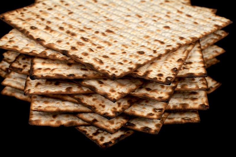 Traditional Jewish matzah on a black background. Close-up Passover Baked Black Black Background Bread Breakfast Brown Close-up Cracker Focus On Foreground Food Food And Drink Freshness High Angle View Indoors  Indulgence Kosher Matza Matzah Matzo Matzoth No People Pattern Pesach Ready-to-eat Religion SLICE Snack Stack Still Life Studio Shot Temptation Toasted Bread