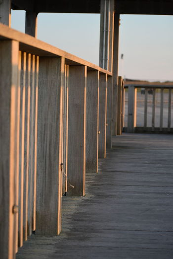 Wood Wood - Material Railing Railing _ Collection Footbridge Fishing Pier Pier Brown Beach Sea Wood - Material Sky Architecture Built Structure Footbridge Pier Wooden Post Railing Mooring Post