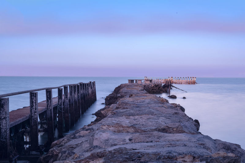 Chalet Beach Beauty In Nature Groyne Horizon Horizon Over Water Idyllic Land Nature No People Non-urban Scene Outdoors Pier Rock Rock - Object Scenics - Nature Sea Sky Solid Tranquil Scene Tranquility Water Wooden Post