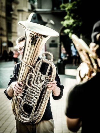 Musical Instrument Musician Saxophone Outdoors Focus On Foreground Street Performance Parade Playing Arts Culture And Entertainment Day Mature Adult Wind Instrument Adult Men City Street Performer Lifestyles Building Exterior