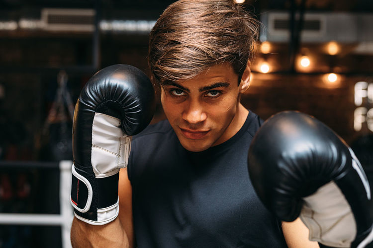 Portrait of man boxing in ring