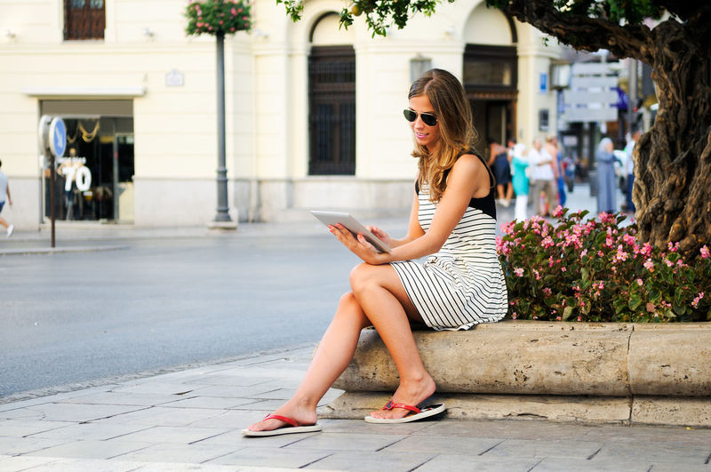 Woman using digital table in city