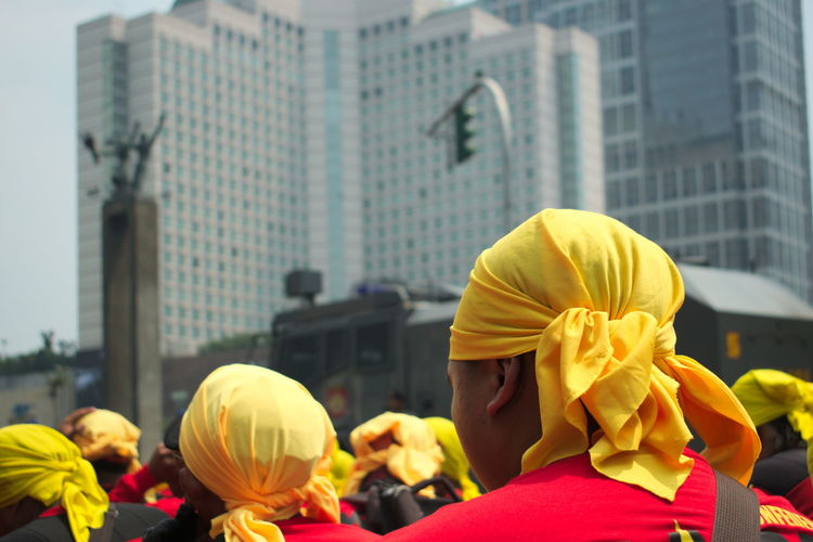 May Day march in Jakarta. City Day Demonstration Flag Headwear Labor Labor Day Large Crowds Large Group Of People March Marching May Day Men Outdoors Parade People Protest Protesters Real People Riot Uniform Walk Wealth Yellow The Photojournalist - 2017 EyeEm Awards The Portraitist - 2017 EyeEm Awards