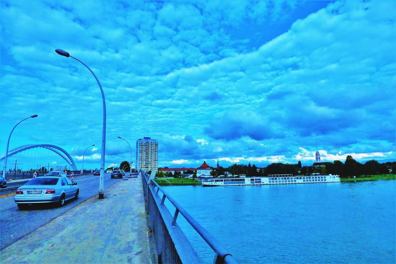 Bridge Cloud - Sky Water Harbor Sky Outdoors Pier Travel Destinations Sea Architecture No People Commercial Dock Built Structure Nautical Vessel Day Blue Beach Building Exterior Nature City Cityscape