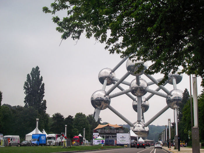 Travel Destinations Foggy Morning Foggy Weather Atomium Brussels Atomiumview Tree Area Carousel Tree City Amusement Park Ride Ferris Wheel Amusement Park Arts Culture And Entertainment Sky Office Building Visiting Chain Swing Ride