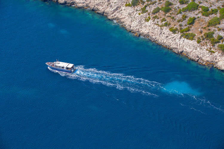 Crossing boat on the blue waters of the mediterranean in the calanques national park