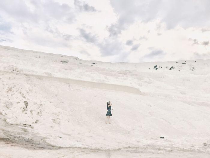 Woman on sand against sky