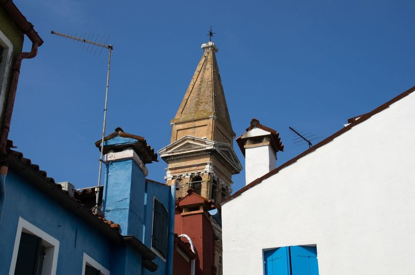 Architecture Bell Tower Blue Building Exterior Built Structure Burano Chimney Clear Sky Colourful Day Italy Low Angle View Outdoors Painted Houses Place Of Worship Sky Tower Travel Venice Venice, Italy