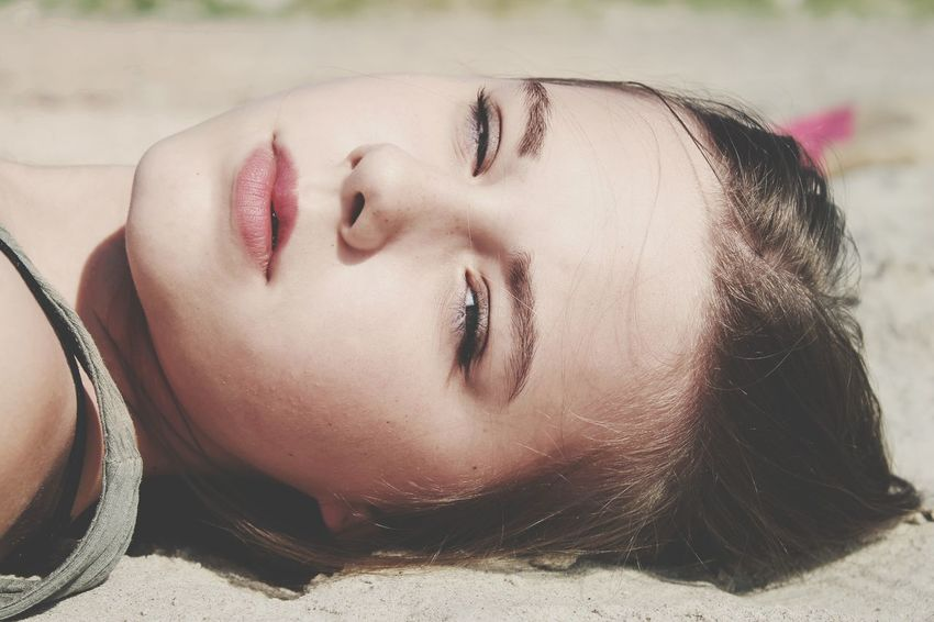 EyeEm Selects Eyes Closed  Only Women One Woman Only People Beautiful Woman Young Women Human Face Outdoors Beauty Headshot Women Portrait Close-up Lying Down One Person