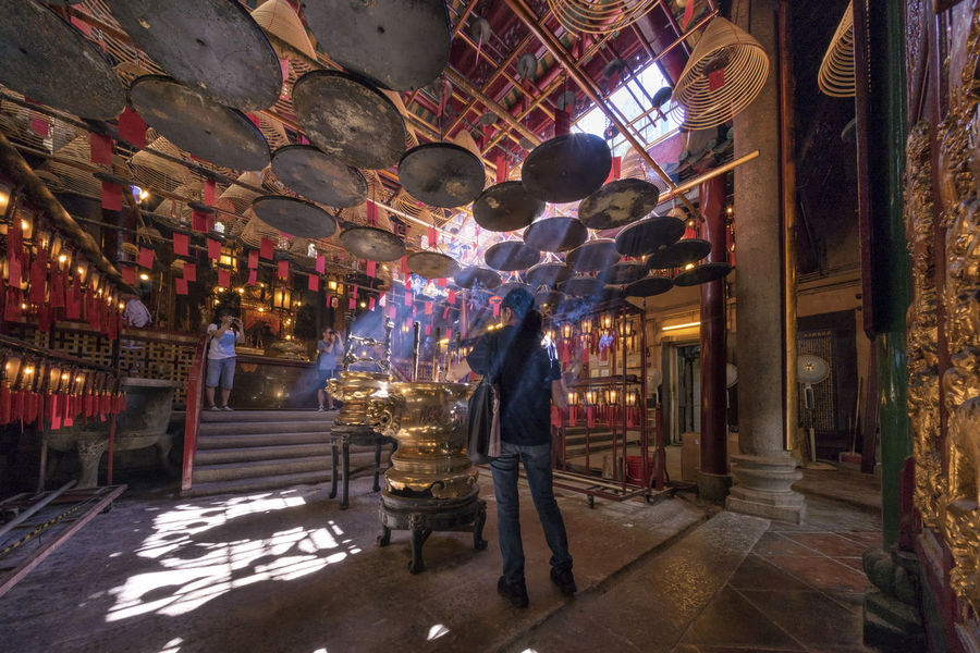 Blessing Man Mo Temple Rays Of Light Adult Architecture Blessing Building Built Structure Business Decoration Full Length Group Of People Illuminated Indoors  Lighting Equipment Lights And Shadows Men Motion Night People Real People Rear View Standing Walking 文武廟