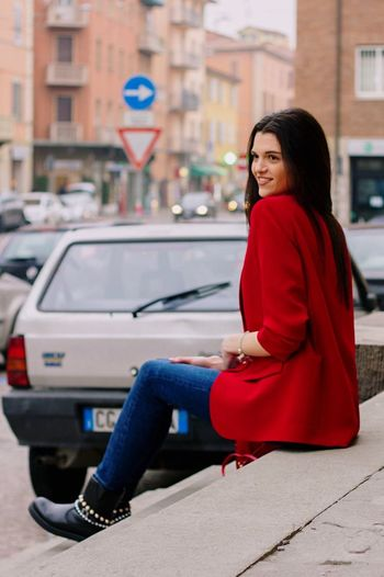CODERED Adult One Young Woman Only Adults Only Street Sitting Smiling People Beautiful Woman Full Length Side View Beauty Beautiful People Women Casual Clothing Adventures In The City The Modern Professional