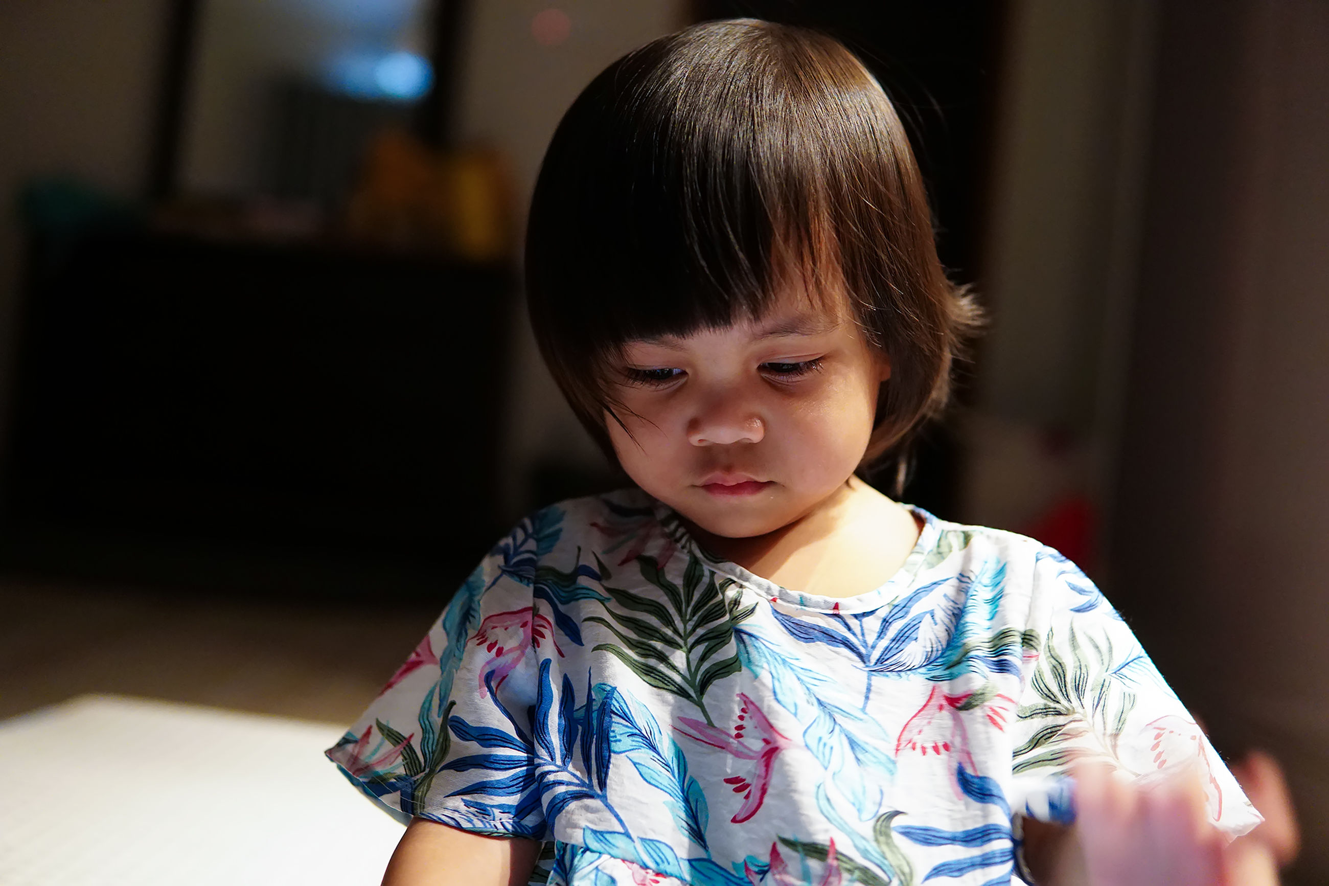 childhood, child, one person, real people, front view, indoors, innocence, casual clothing, focus on foreground, lifestyles, girls, home interior, females, cute, looking, waist up, women, bangs, floral pattern, hairstyle