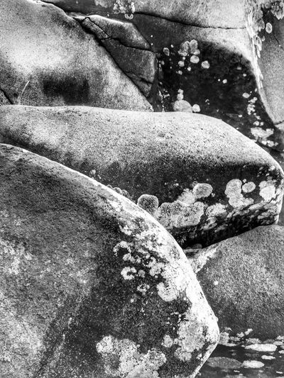 Abstractions In BlackandWhite Rock Formation Weathered Outdoors Nature Close-up Natural Architecture Rock - Object Landscape Beauty In Nature Shapes In Nature  Abstract Nature Layers And Textures Perspective Scenic Backgrounds Abstractions Natural Condition Stone - Object Textured  Moss & Lichen Power In Nature Black And White Stones Scenics