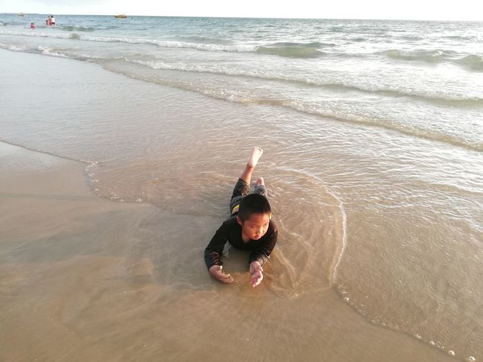 Children enjoy on summer trip 2019,หาดเจ้าหลาว Achi2019 Water Sea One Person Beach Leisure Activity Land High Angle View Real People Lifestyles Motion Beauty In Nature Day Weekend Activities Portrait Nature Full Length Young Adult Sand Human Arm Outdoors Boy