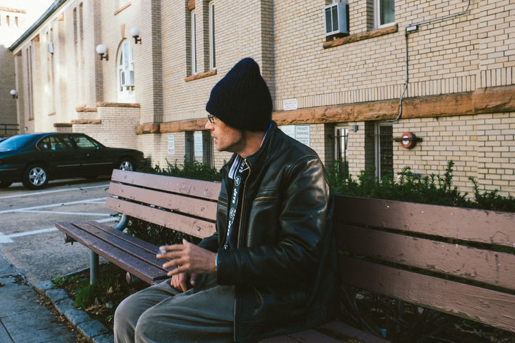 Man sitting in front of building