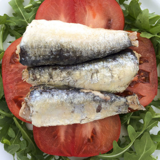 Sardines and tomato slices on a bed of Rocket salad leaves Close-up Detail Directly Above Food Food And Drink Freshness Healthy Eating Healthy Food Leaves Omega 3 Omega 3 Fatty Acids Omega 3 Oils Organic Rocket Salad Salad Leaves Sardine Sardines Sea Food Still Life Tomato Tomatoes