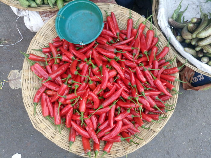 High Angle View Of Red Chili Pepper In Basket At Market