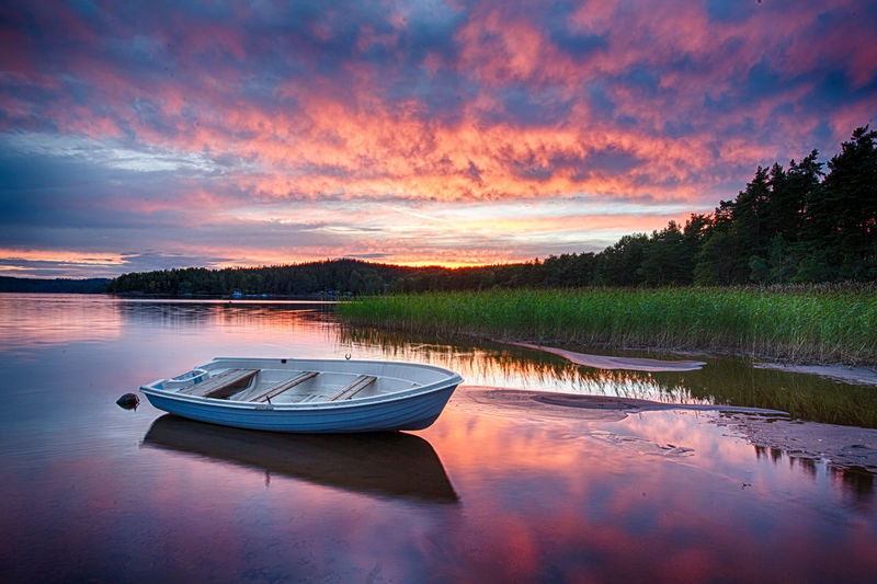 Down by the lake the sky is on fire Dramatic Sky HDR Holiday Rowboat Sweden Beauty In Nature Boat Calm Lake Fishing Lake Outdoors Reflection Romantic Sky Sunset Water