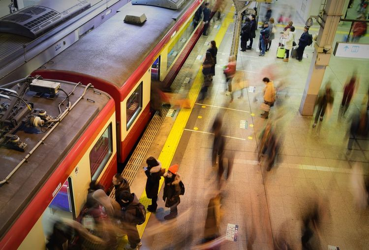 Blurred motion of people on railroad station