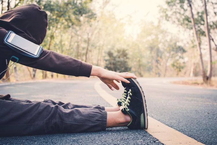 Man exercising on road