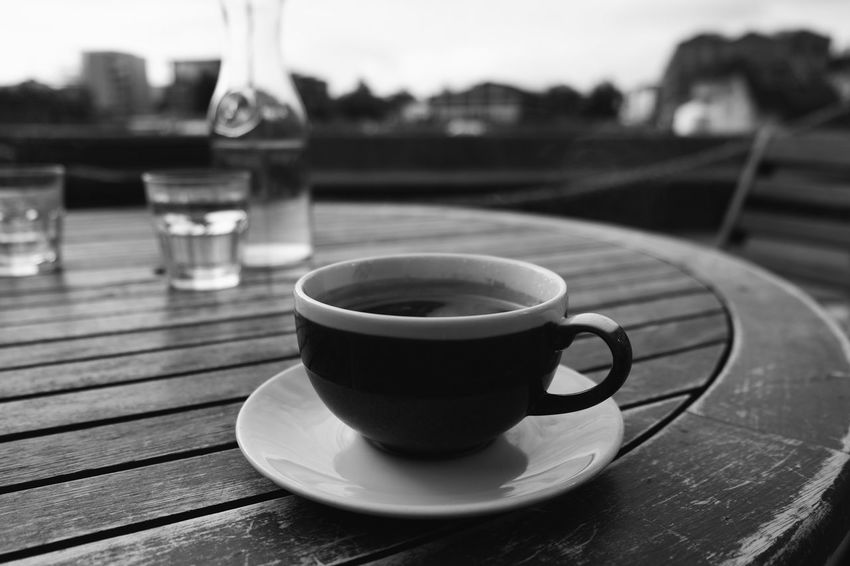 Table Drink Refreshment Food And Drink Focus On Foreground Coffee Cup Coffee - Drink Wood - Material No People Saucer Freshness Close-up Outdoors Day Water FUJIFILM X-T10 F/3.2 Iso 200 XF18-55mmF2.8-4 R LM OIS via Fotofall