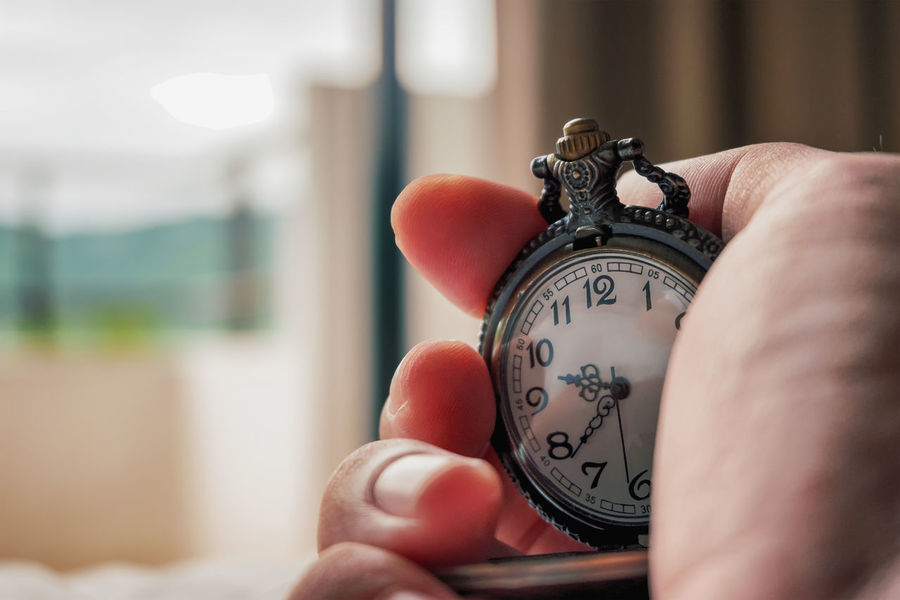 sunrise in the morning with hand hold Ancient clock on in bedroom. You can't recycle wasted time. Business Holiday Lover Morning Wasted Ancient Clock Bedroom Clock Clockwise Day Expectation Health Holding Human Finger Human Hand Metal People person Recycle Sleep Sunrise Time Timepiece Wake Up Wake Up Late